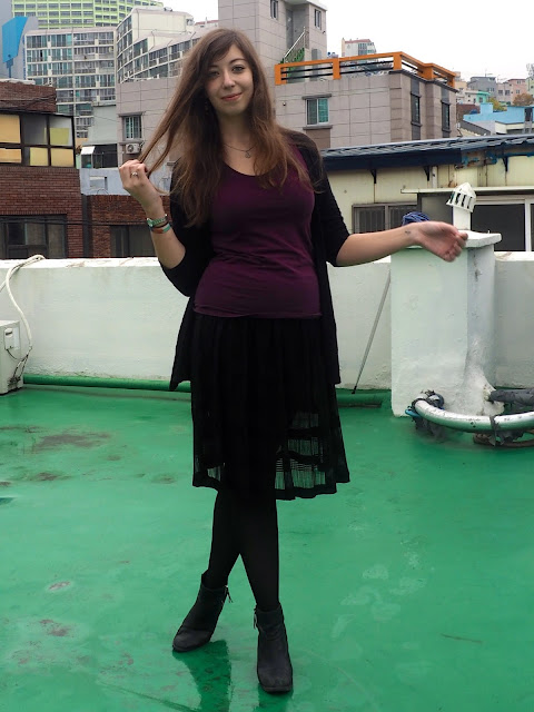 Gossamer Dreams | outfit of plain purple t-shirt, black cardigan, black semi-transparent floaty skirt and black heeled ankle boots
