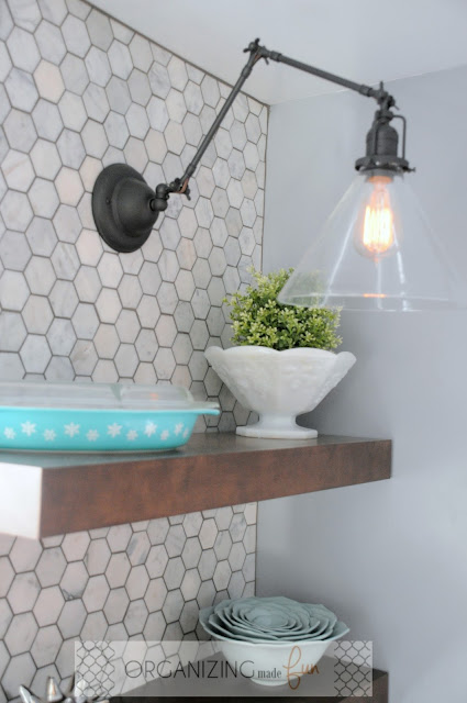 Bronze swing-arm sconce with clear glass shade and edison bulb :: OrganizingMadeFun.com