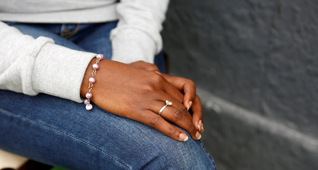 Image Attribute: The hands of Eritrean migrant Ruta Fisehaye are seen as she poses for a photograph in Catania, Italy, May 11, 2016. REUTERS/Antonio Parrinello