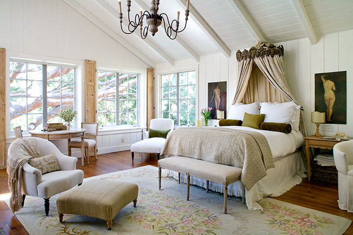 Romantic farmhouse style bedroom with canopy bed, linen, and Swedish antiques by Giannetti Home