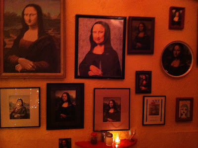 pictures of mona lisa on the walls of the italian restaurant mona lisa in new orleans