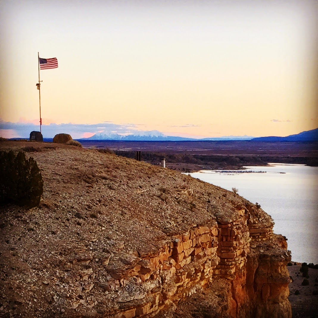 american flag and mountains