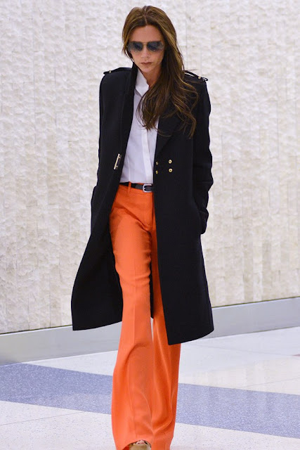 CELEBRITY STYLE TRANSFORMATION Victoria Beckham at the airport in a black orange trousers