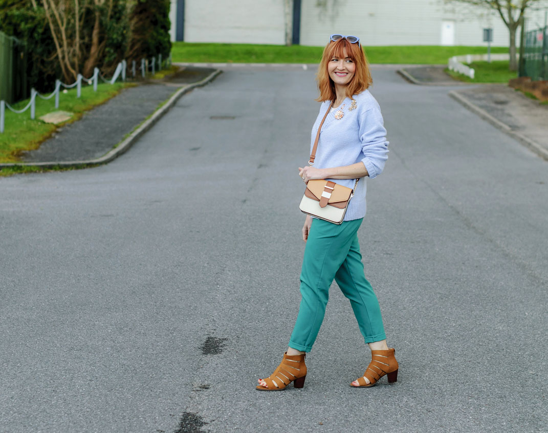 Spring look: Pale blue sweater emerald green peg trousers flower brooches tan strappy block heeled sandals two tone cross body bag | Not Dressed As Lamb, over 40 style