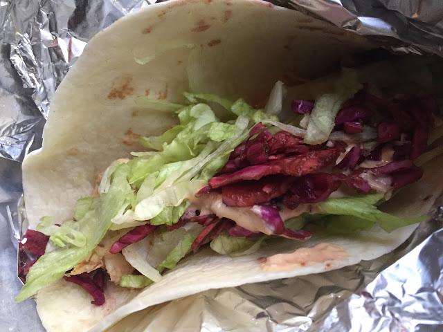 Pollo, lettuce, red cabbage and chipotle crema taco at Condado