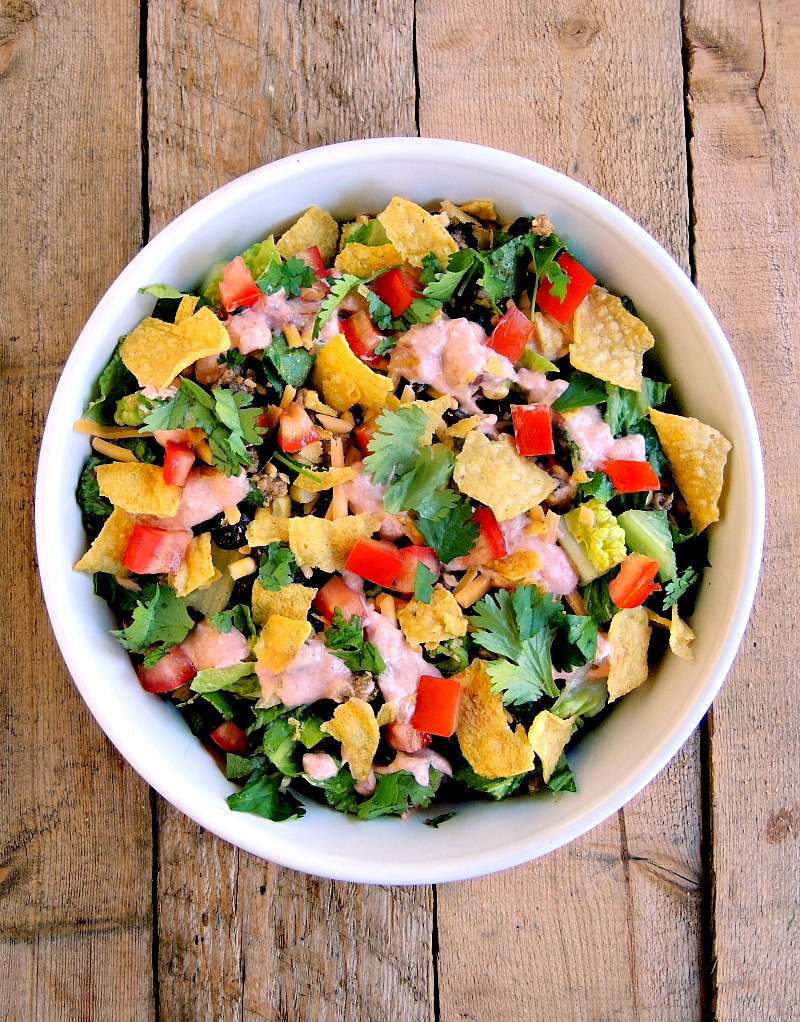 This Nacho Salad, made with chicken and Greek yogurt, is a healthy alternative to the high calorie snacking favorite. From www.bobbiskozykitchen.com
