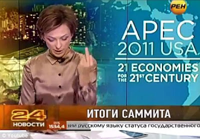 From Russia without love! Newsreader makes one-finger gesture to camera when she mentions Obama's name 1