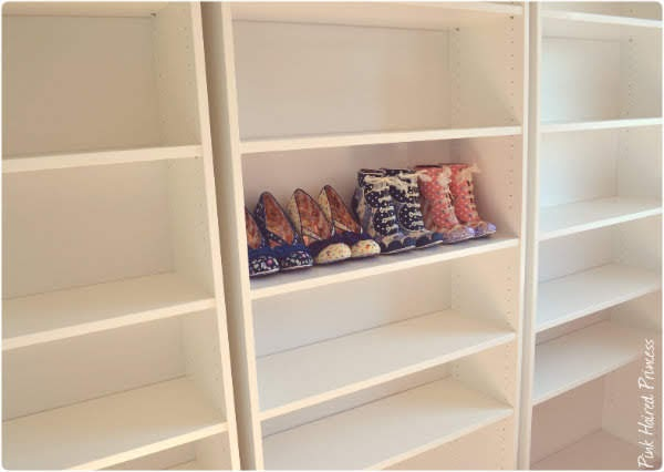 ikea billy bookcase with some shoes on shelf