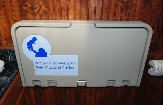 Baby changing station within a private stall.
