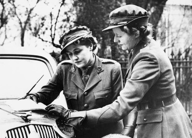 Women of the MTC - An MTC girl gets her orders from her superior on the bonnet of her car