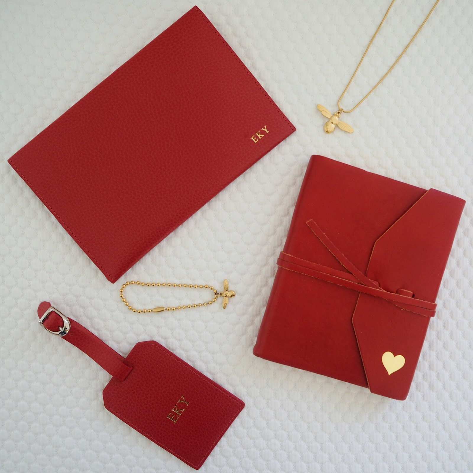 Valentine's gist guide for over 40s, red leather personalised notebook, luggage tag and travel wallet