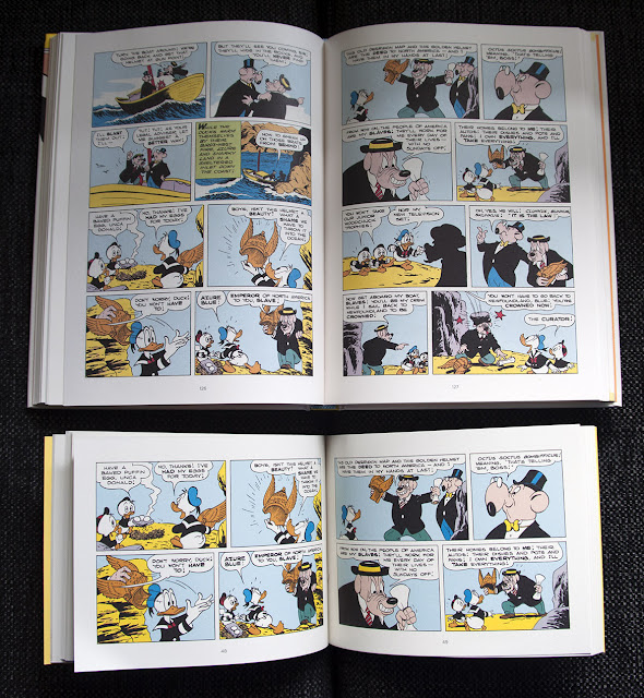 """Inside The Carl Barks Library vol.11 (""""A Christmas For Shacktown"""") and """"The Golden Helmet"""" paperback."""