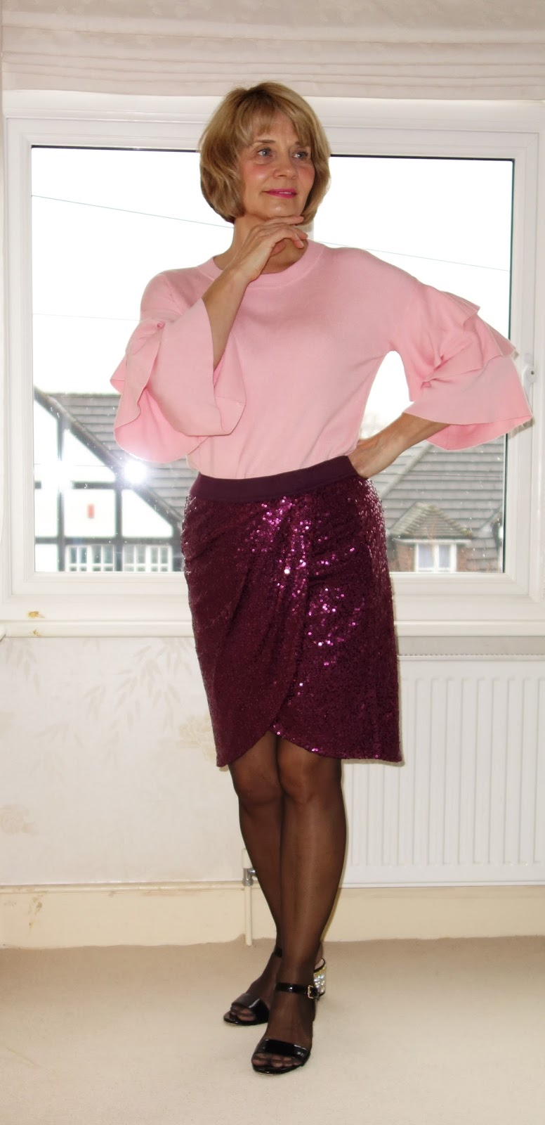 Magenta sequin skirt and Lost Ink pink ruffle sleeved jumper