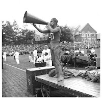 Dartmouth student cheerleader in redface and wearing deerskin leggings at a football game.