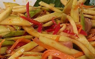 Urap mangga, a crunchy green mango salad.