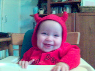 Baby wearing Halloween Costume featuring Devil Horns