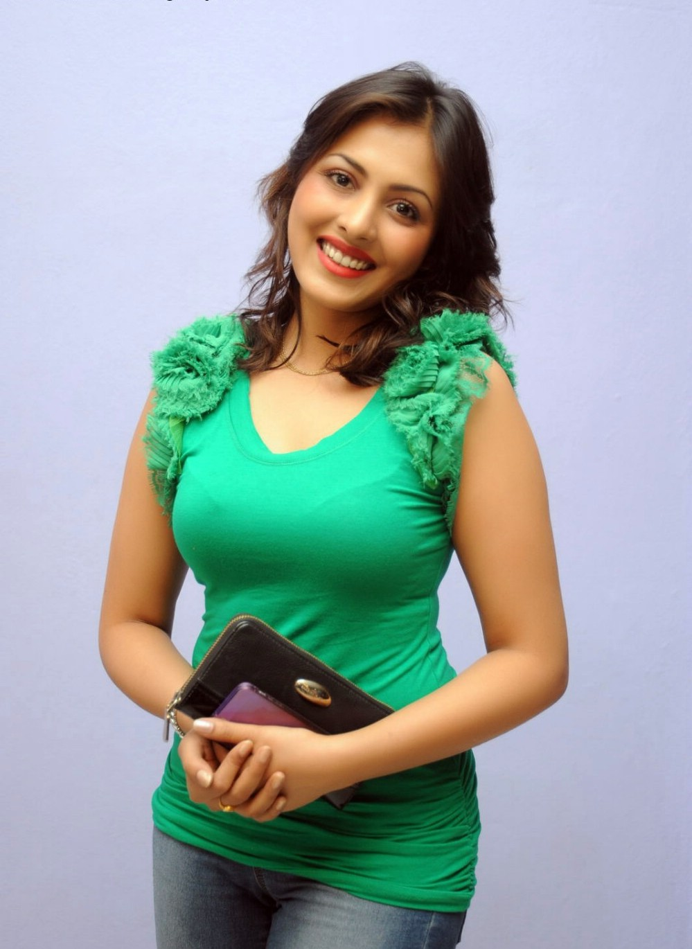 Madhu Shalini Smiling Photoshoot Stills In Green Top Blue Jeans