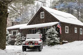 Christmas cabin in the mountains with jeep