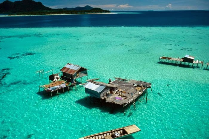 #3. Sabah, Malaysia Sabah is one of the 13 member states of Malaysia. It's located on the northern portion of the island of Borneo. - 12 Places To Swim With The Clearest, Bluest Waters. #2 Wow!