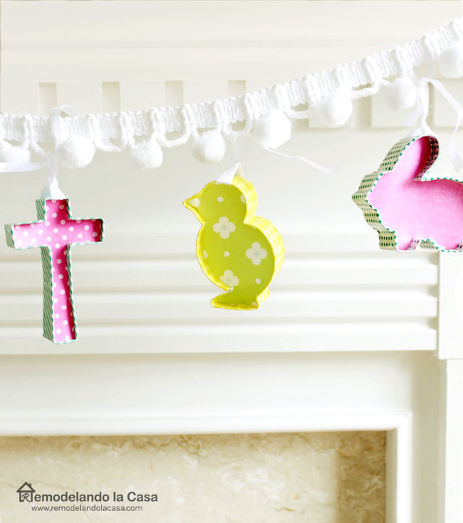 Cookie cutters on the shapes of cross, chick, rabbit as a garland