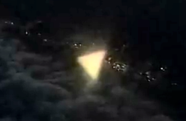 UFO SIGHTINGS DAILY: Glowing Triangular UFO photographed by
