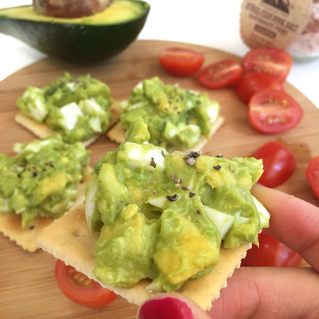 Serving Avocado Egg smash on healthy crackers