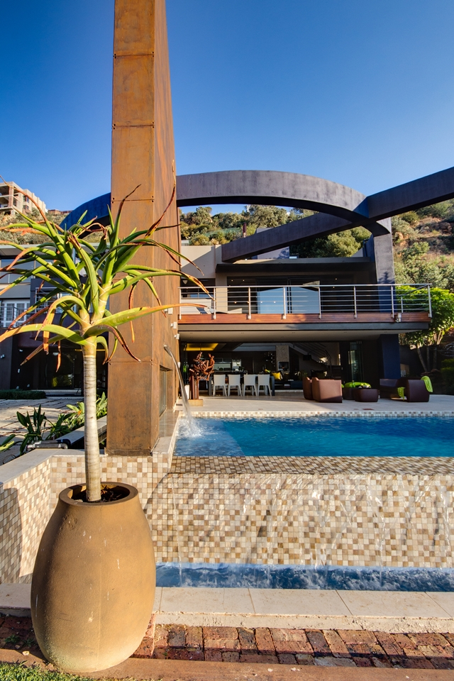 Modern villa as seen from the edge of the swimming pool