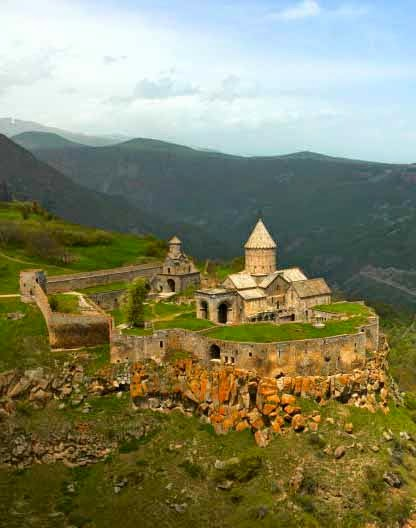 "The Tatev Monastery  is a 9th-century monastery located on a large basalt plateau near the Tatev village in Syunik Province in southeastern Armenia. The term ""Tatev"" usually refers to the monastery. The monastic ensemble stands on the edge of a deep gorge of the Vorotan River. Tatev is known as the bishopric seat of Syunik and played a significant role in the"