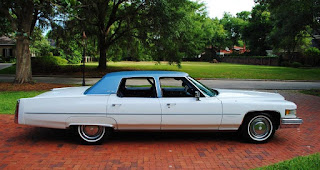 White 1976 Cadillac Fleetwood Brougham Side
