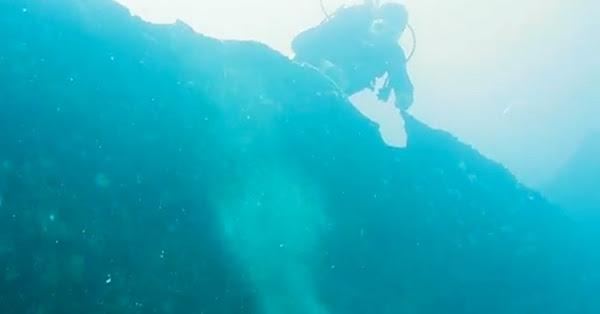 Another Scuba Diver monitors the rare event.