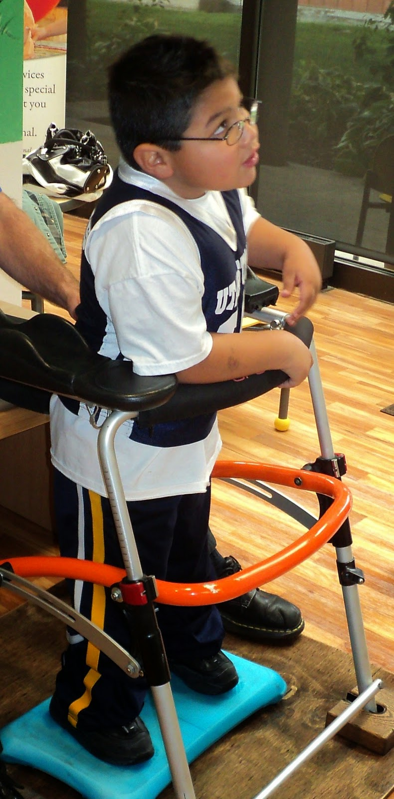 Six-year-old Dillon using a stand during therapy built at the AT lab.
