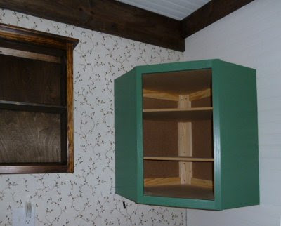 green painted corner wall cabinet