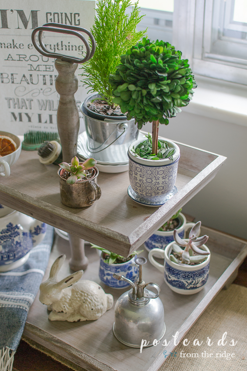 blue and white and natural items in a wood tiered tray