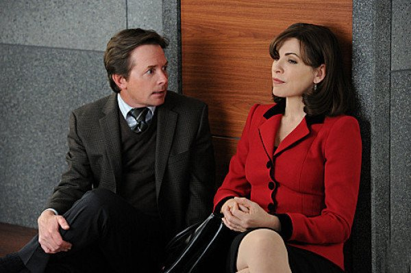 The Good Wife – Louis Canning (Michael J. Fox) and Alicia (Julianna Margulies) sit together on floor leaning against wall