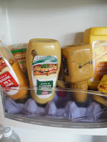 "Store your mustard, upside down! Try this easy ""egg carton"" tip. No more mustard water dropping on your sandwich."