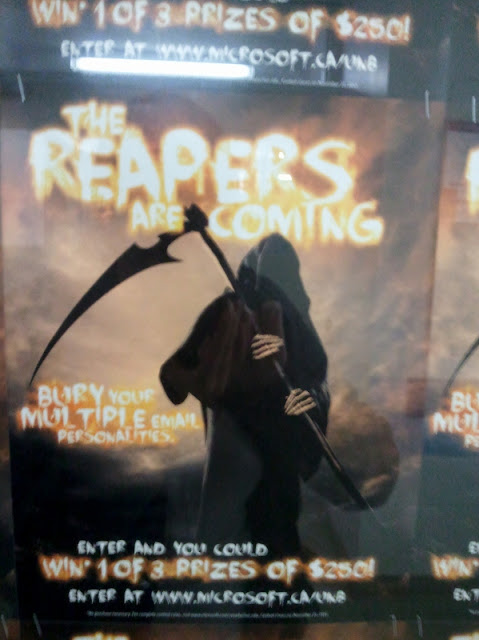 Poster of a Reaper figure with text, 'The Reapers are Coming. Bury your multiple email personalities'