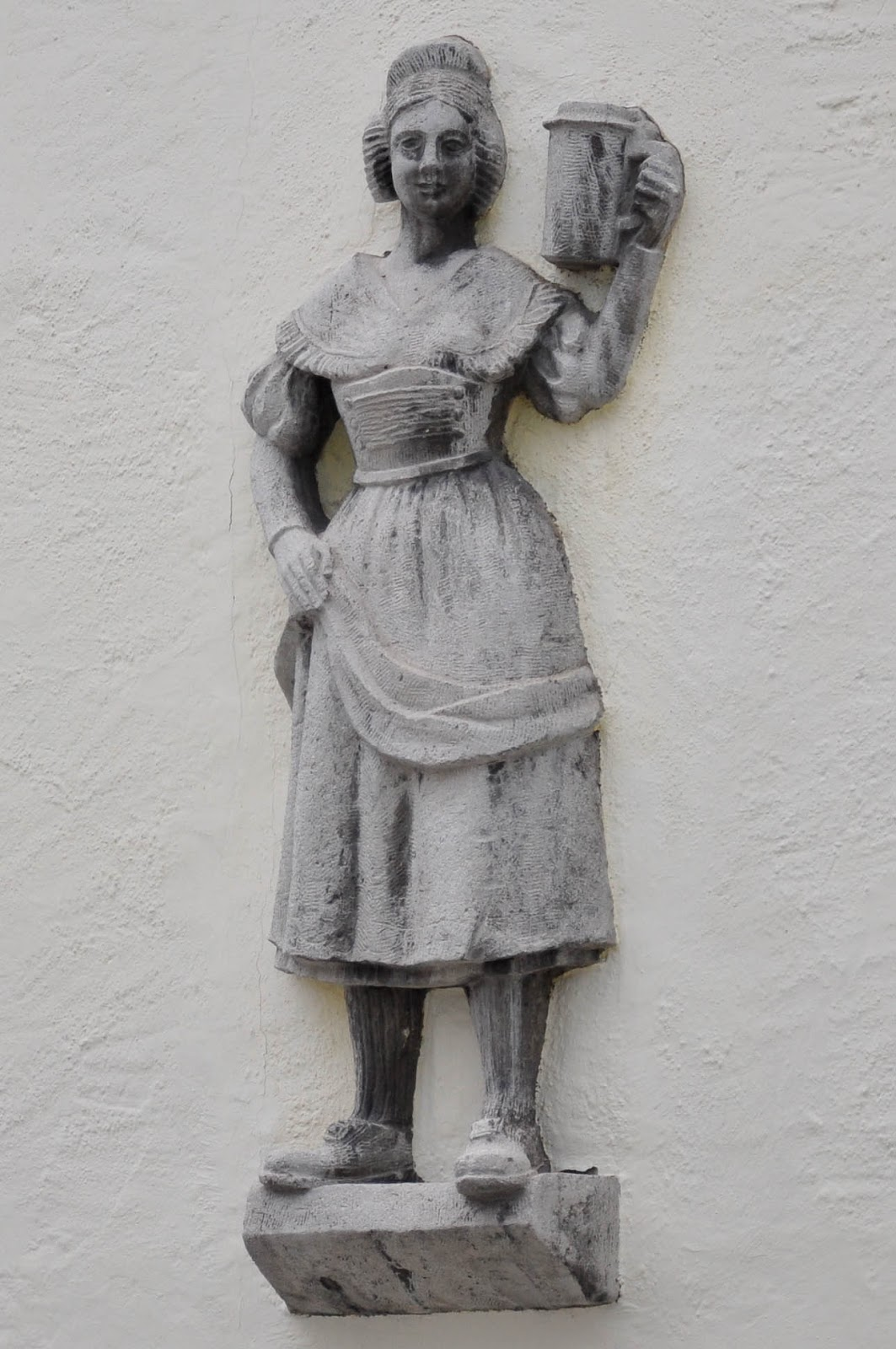 Bas-relief on a house wall, Garmisch-Parternkirchen, Bavaria, Germany