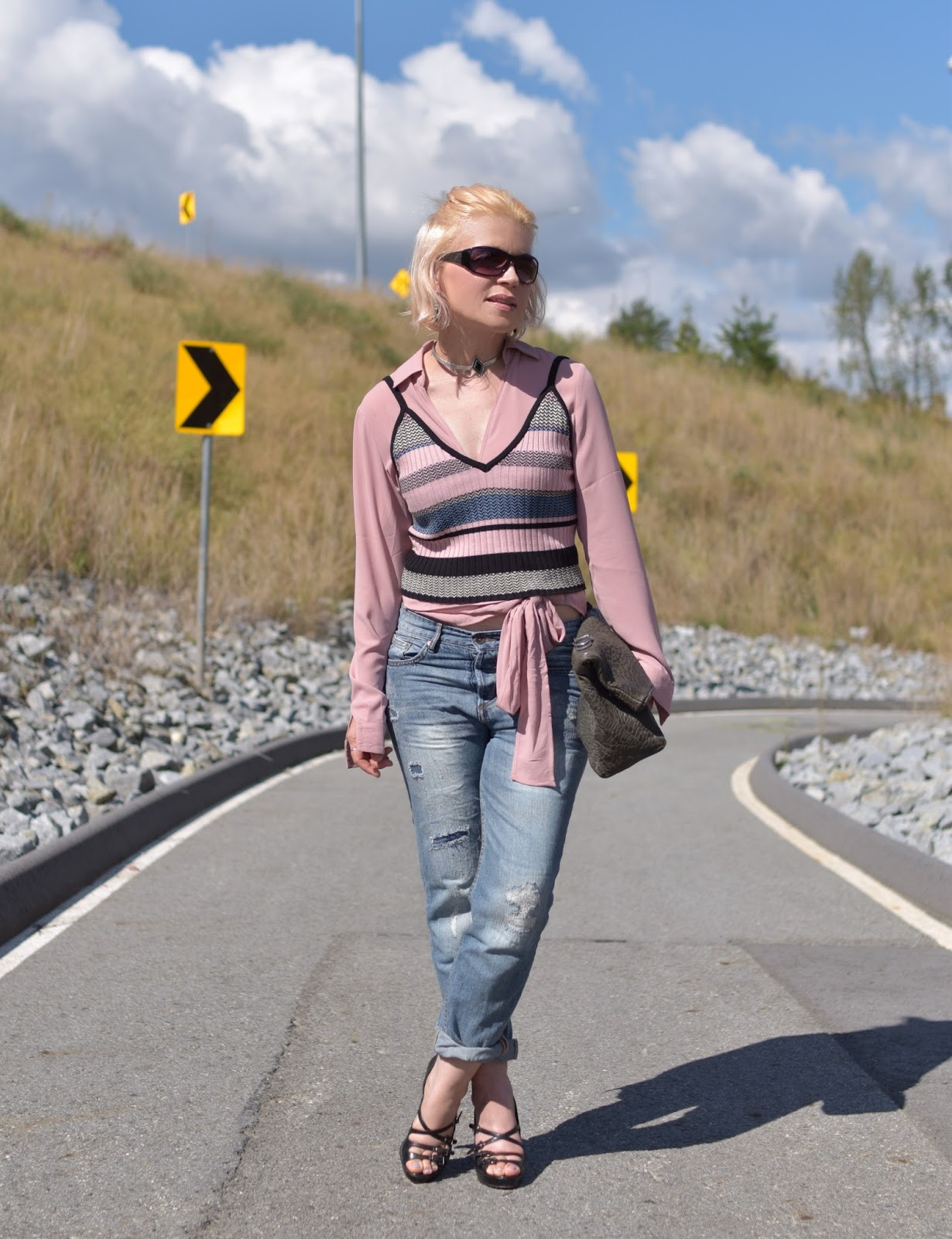 Monika Faulkner styles a striped knit tank over a front-tied blouse, with boyfriend jeans and strappy shoes