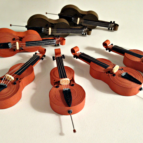 seven miniature quilled paper cellos