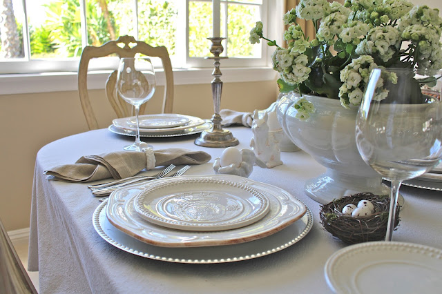 neutral easter tablescape white plates flowers ironstone