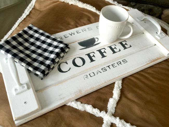 White stenciled coffee tray with coffee cup and napkin