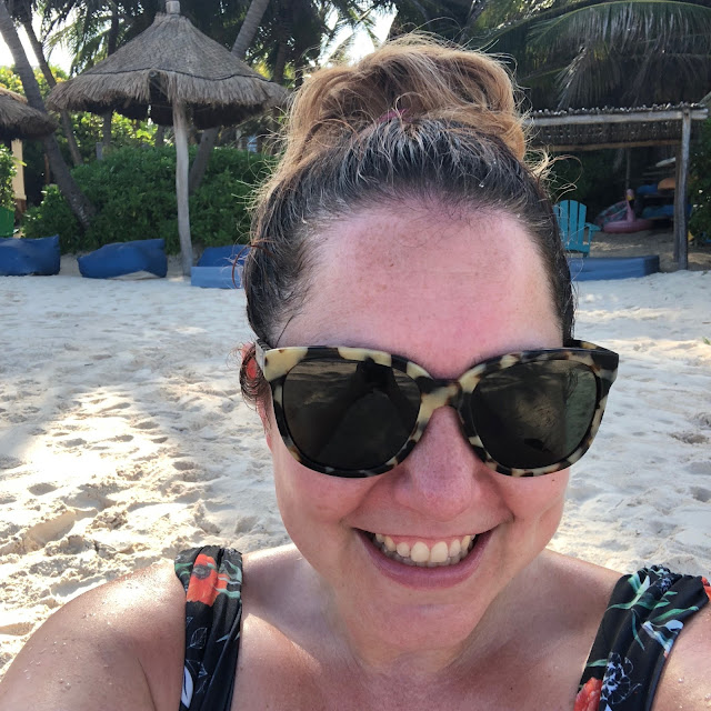 Tulum, travel guide, what to do in Tulum, Jamie Allison Sanders, Warby Parker Riley sunglasses, ballerina bun, Caribbean Sea, beach