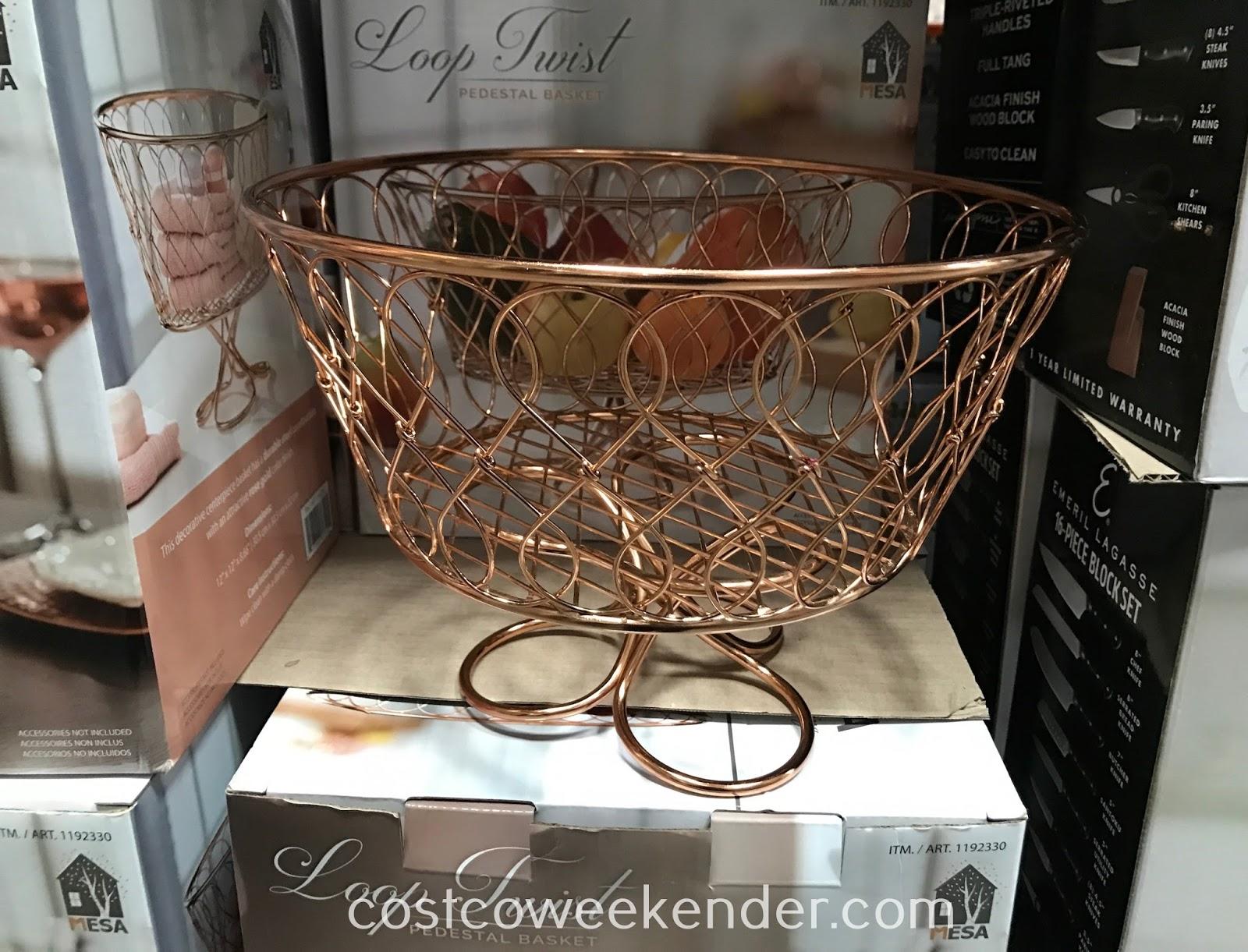 Have a practical vessel to place fruit in with the Vanderbilt Loop Twist Pedestal Basket
