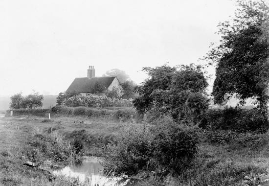 Photograph of The missing Warrengate Road coal post in the 1900s - white post middle left of picture Image by G. Knott courtesy of the Peter Miller Collection