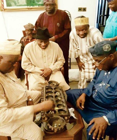 Obasanjo Playing ayo game as Jonathan Other watch in his village