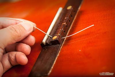 Cách thay dây đàn guitar Classical