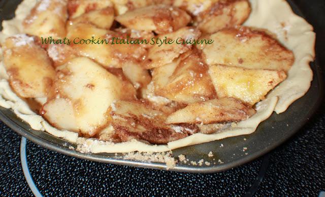apples inside raw pie crust dough
