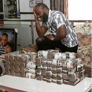 Singer Kcee Poses With Bundles Of Money On His Table (Photo)