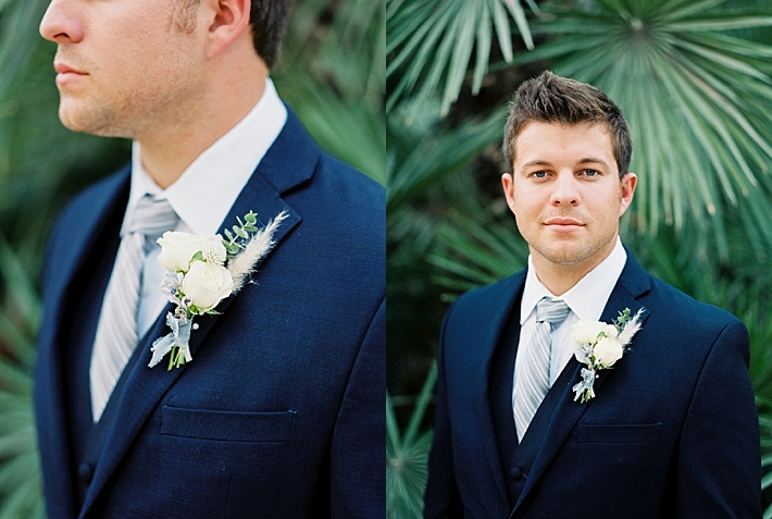 Navy blue groom's suit with white boutonniere | Photo by Dennis Roy Coronel | See more on thesocalbride.com