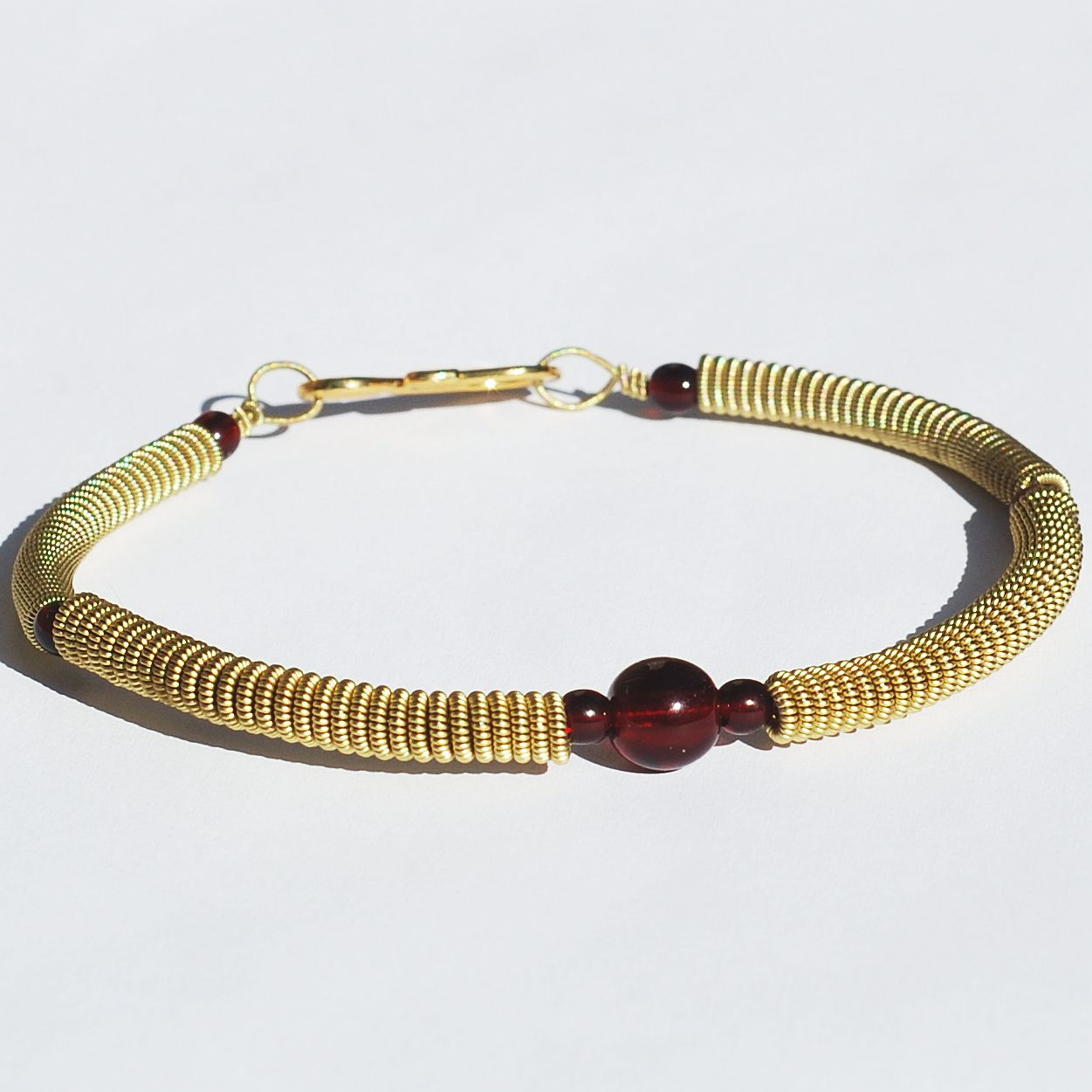guitar string jewelry by tanith rohe guitar string bracelet garnet red and brass upcycled jewelry. Black Bedroom Furniture Sets. Home Design Ideas